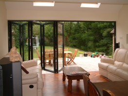 Marvin Architectural Aluminum Bi-Fold Doors deliver elegant contemporary design with ultra slim aluminium frame profile. The use of precision engineering and high performance components combine to deliver bi-fold doors of matchless quality.