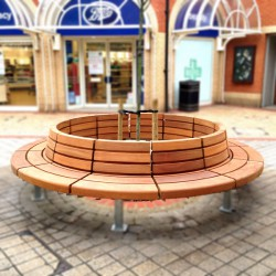 The Woodscape range of high-quality seating combines a simple, natural appearance with a robust construction to resist vandalism.Manufactured in Naturally Very Durable Hardwood, the Westbrook Seat is available in any size and radius and can be straight or curved. With a choice of surface fixed (SF) or built-in 200mm below ground (BI).The unique features of this seat when chosen in a circular configuration is the addition of a uniformed circular backrest which can be part sloping. A number of design features are also available including armrests, adjustable legs to accommodate tree roots, recessed LED lighting, skirts with access panels, routed text and trickstoppas to deter skateboarders.Our in-house designers can draw on many years experience of working with the world's most durable timbers, to fully exploit the design potential of hardwood.Whether it's a small urban project or an expansive scheme, our team fully commits their innovative capabilities to creating beautiful outdoor furniture that will enhance the aesthetics and functionality of public spaces.