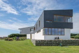 Characterised by its contemporary design, the CUPACLAD® 201 VANGUARD rainscreen cladding system marries large format slates with stainless steel clips, creating a clean, modern combination.