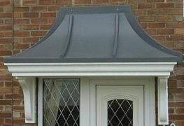 A realistic traditional door canopy with rolled-lead effect top over a smooth fascia & soffit.  Designed to compliment any door opening, and available in a range of widths. Also suitable for bay tops. Manufactured in strong rigid GRP, and simple two piece moul...