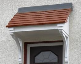 A mono-pitch clay tile effect roof with woodgrain effect base,  A traditional overdoor canopy, with the classic look of clay tiles over a timber base. This canopy has been designed to faithfully reproduce the appeal of this popular product without the disadvan...