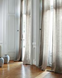 Semi-transparent curtain fabric; This contemporary linen fabric captivates with the rustic grid texture of its linen weave....