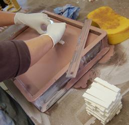 Hand dipping involves dipping tiles face down into a ceramic glaze, for a period of time by hand. When the tile is removed subtle differences in depth of the glaze, this gives each tile a unique characteristic of different shades across the surface.   We use s...