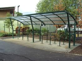 The Didcot Cycle Canopy is a popular shelter thanks to its contemporary good looks and versatility.  Available as a stand alone standard 3850mm version that holds up to 10 bikes or because of its modular design it can hold as many bikes as you require. Its simple to extend if you decided at a later date that you require more space by using one of our bolt on extension units.  As standard the Didcot Cycle Canopy comes galvanized, you also have the option to have your shelter painted Powder Coated) Its your choice. The shelter also comes with a 5 hoop 10 space toastrack.  All of our shelters are delivered flat pack and are manufactured with ease of installation in mind, all shelters come with full instructions and bolt kit  The Didcot Cycle Canopy can also be fitted with various styles of cycle racks.  ALL OF OUR SHELTERS CAN BE GALVANISED  Products that are hot-dip galvanized (to BS EN ISO 1461) can outlast paint / powder Coatings by up to 20 years.  This shelter could also provide you with a solution to motorcycle parking, lockers or double tier cycle racks.  Bolt on extension modules available in 2000mm or 4000mm versions.