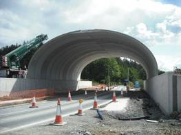 The BEBO Concrete Arch Bridge System from ASSET is a pre-engineered system built from factory-made components and site-specific construction materials. Pre-cast concrete arch sections are shipped to site for installation. The structure is backfilled with engin...