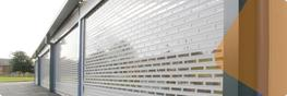Punched lath and glazed roller shutters provide the see-through protection required by many local authorities for high streets and modern shopping centres.  A combination of solid and punched slats achieves optimum strength while delivering up to 65% vision. T...