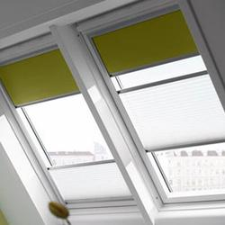 A combination of the classic VELUX blackout blind and  the semi-opaque VELUX pleated blind. Block out as much of the light as you want with the blackout blind then use the semi-opaque pleated blind to diffuse the rest of the light that enters the room. The VE...
