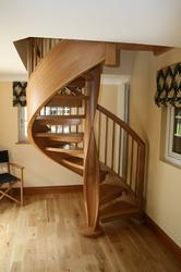 A truly stunning piece of craftsmanship! This spiral staircase has a handcrafted twisted centre column and side string, with curved treads to create a sweeping feeling. This design of spiral stairs is made in one piece so fixings are hidden....