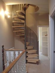 SCANDINAVIAN SPIRAL STAIR WITH TIMBER RISER BARS image
