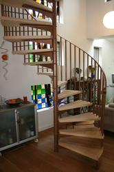 SCANDINAVIAN SPIRAL STAIR WITH STEEL RISER BARS image