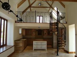 SCANDINAVIAN SPIRAL STAIR WITH WROUGHT IRON BALUSTERS image