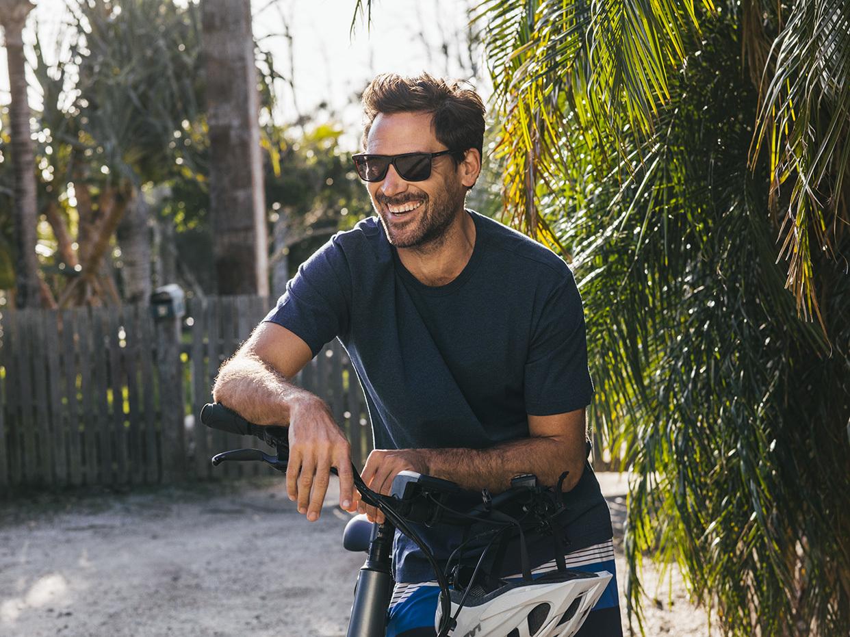 Man riding a bike wearing glasses