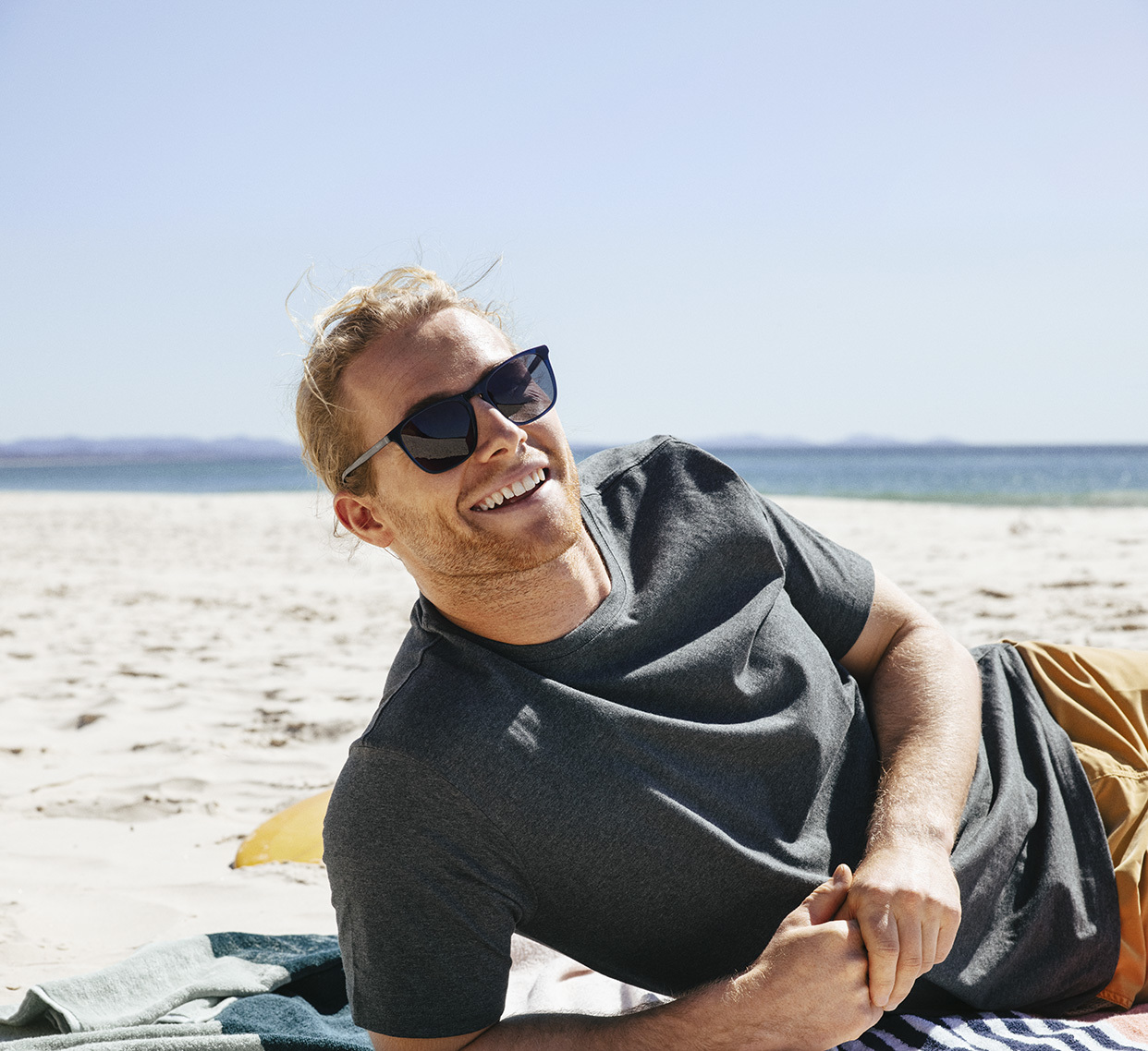 Man on beach wearing sunglasses