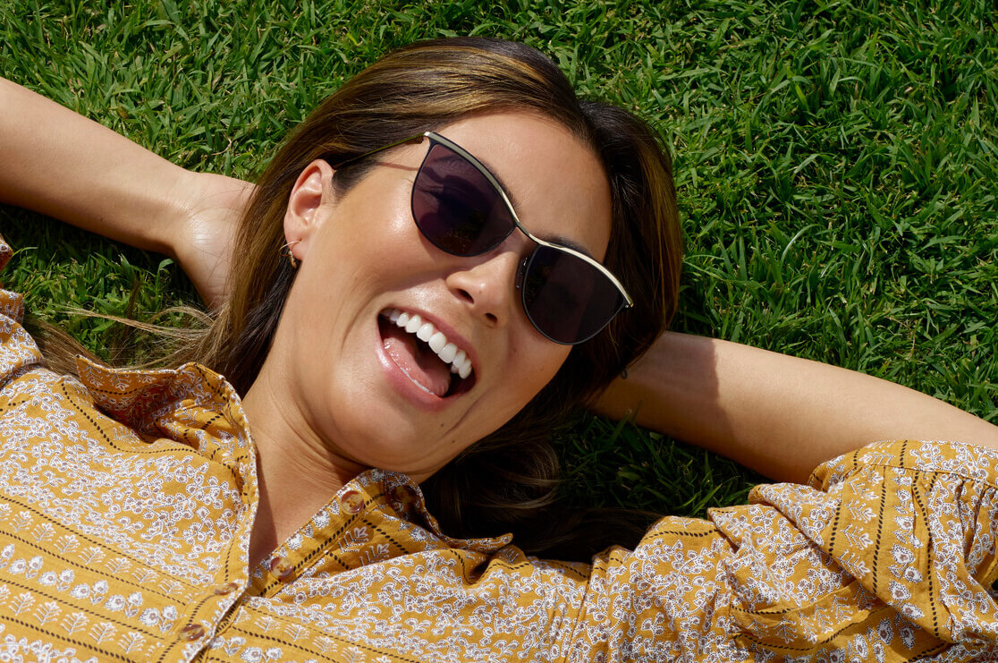 Chrisina in the grass wearing C ZAMPATTI SUN RX 17