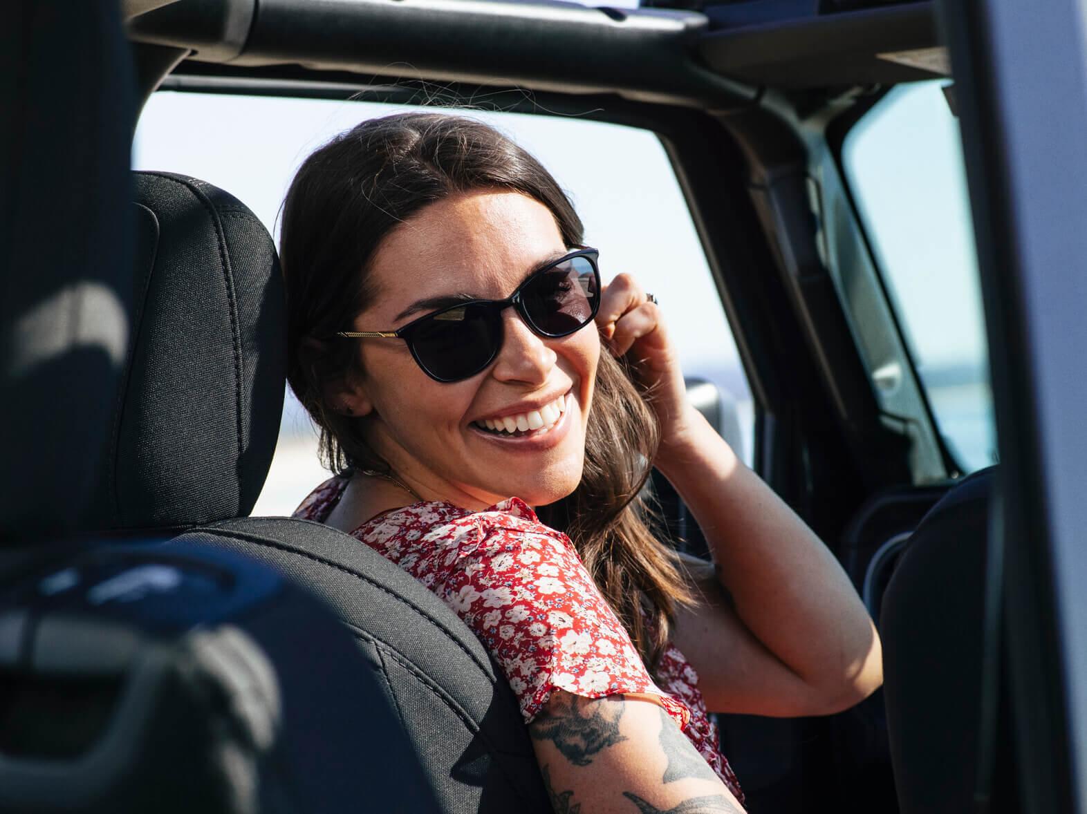 Callie in her jeep wearing KAREN MILLEN SUN RX 12