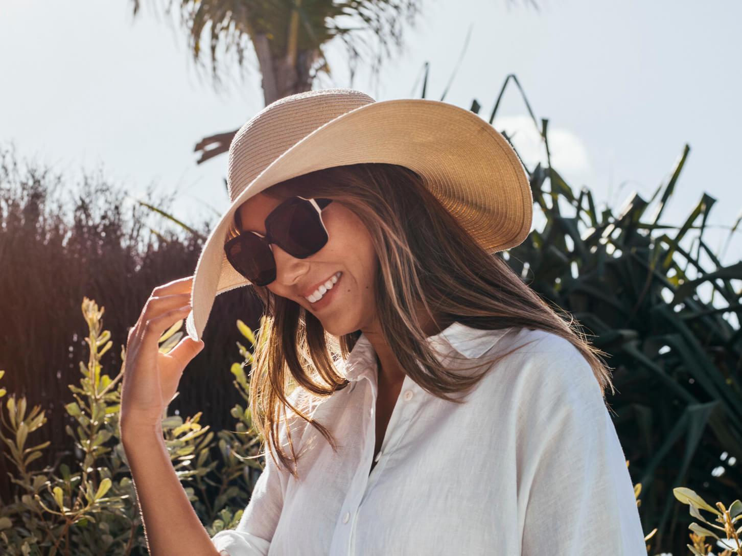 Christina in her hat wearing C ZAMPATTI SUN RX 18