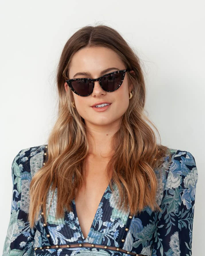 Model wearing cat eye sunglasses