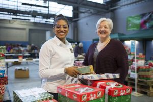 Tyra processing shoebox gifts at the Cardiff Processing Centre