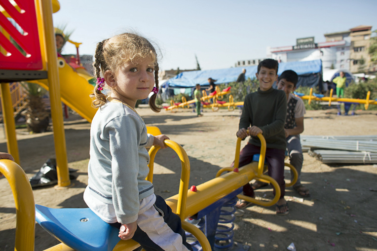 Playground equipment provided by Samaritan's Purse helps bring joy to children in the camp.