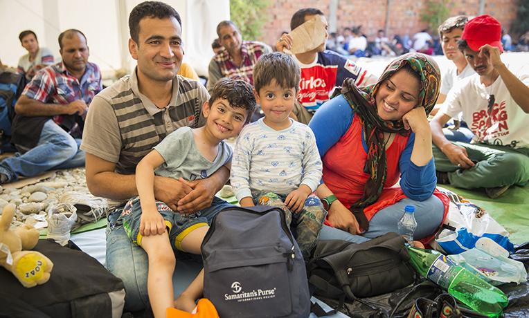 Refugees Receive Backpacks in Macedonia