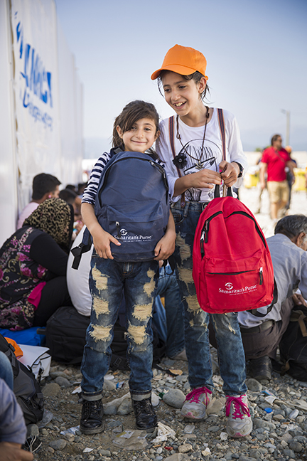 Tala, 11, and Tima, 9, from Syria received backpacks from Samaritan's Purse on September 17.