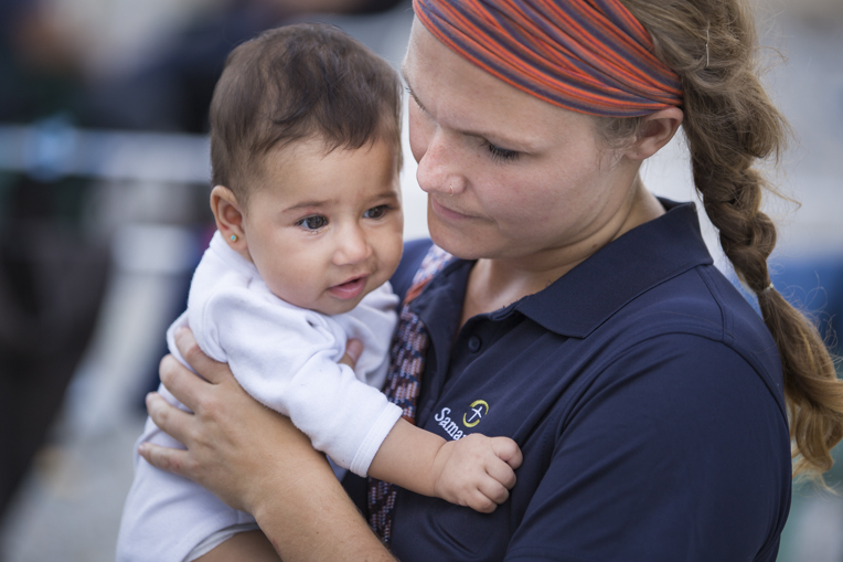 Ibraheem's youngest daughter, Rana, is only 7 months old. She'll have no memories of Syria, but Ibraheem still hopes she returns to her homeland one day. She is pictured here with Samaritan's Purse disaster assistance response team member Hannah Hamrick.