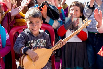 Music brings some joy into the lives of children who've fled ISIS terror.