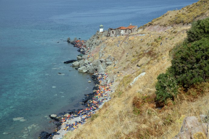 Life jackets and rubber dinghies scatter the coast of Lesbos Island in Greece.