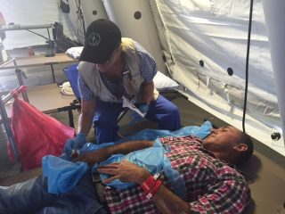Alex Saltos is being treated by our medical staff in Chone.