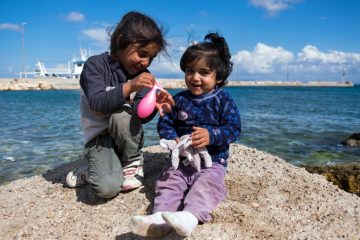 Refugee children still play and laugh despite the difficulties they and their families face.