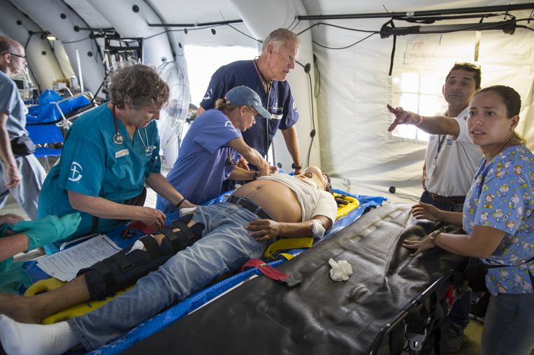 Staff at work in the field hospital in Chone, Ecuador. Mabel Lojan is at far right.