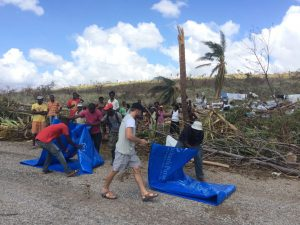 Handing out tarps in Nan Dupin, one of Haiti's hardest hit areas.