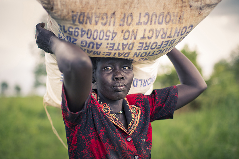 Woman carries food aid sack on her head