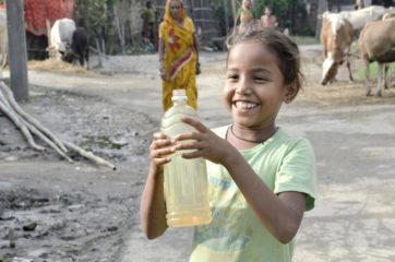 A Nepalese girl collects clean water provided by Samaritan's Purse
