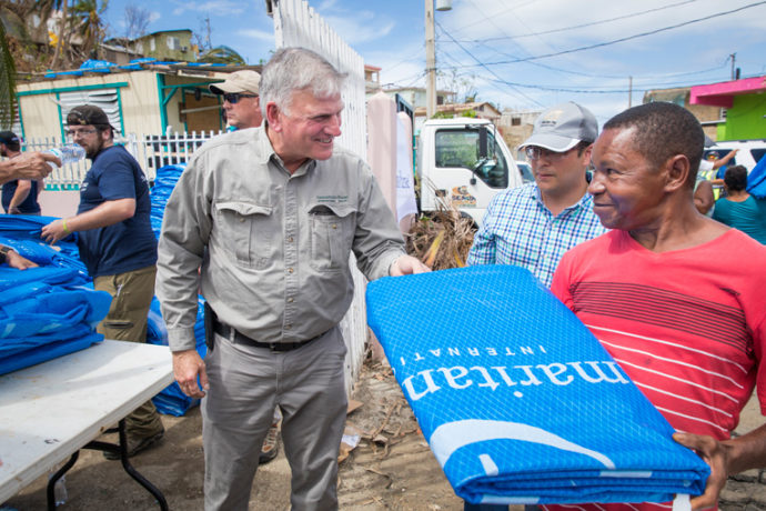 FRANKLIN GRAHAM WORKED TO DISTRIBUTE HEAVY-DUTY SHELTER KITS IN PUERTO RICO ON MONDAY.