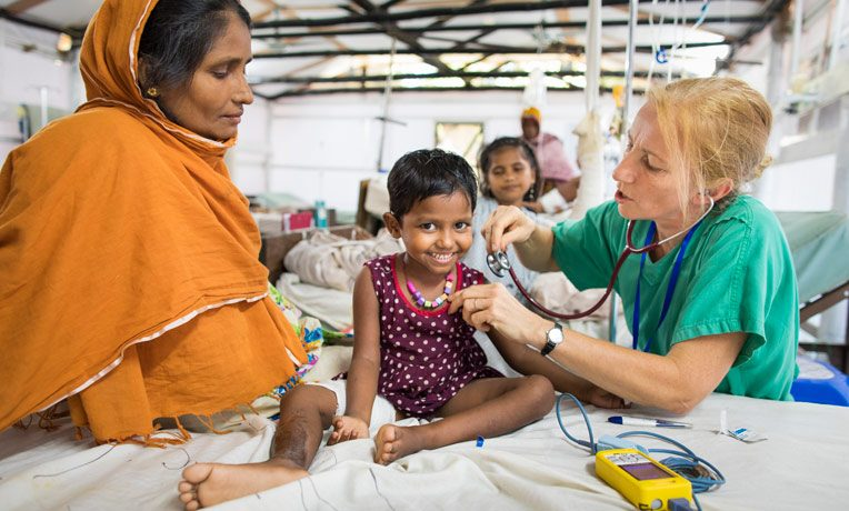 SAMARITAN'S PURSE IS PROVIDING MEDICAL CARE TO ROHINGYA REFUGEES. PICTURED: DR. PAULINE ANTHONY EXAMINES A PATIENT