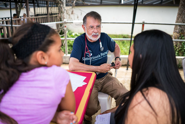 Dr. Carlos de la Garza listened with compassion as he saw patients with a variety of ailments.