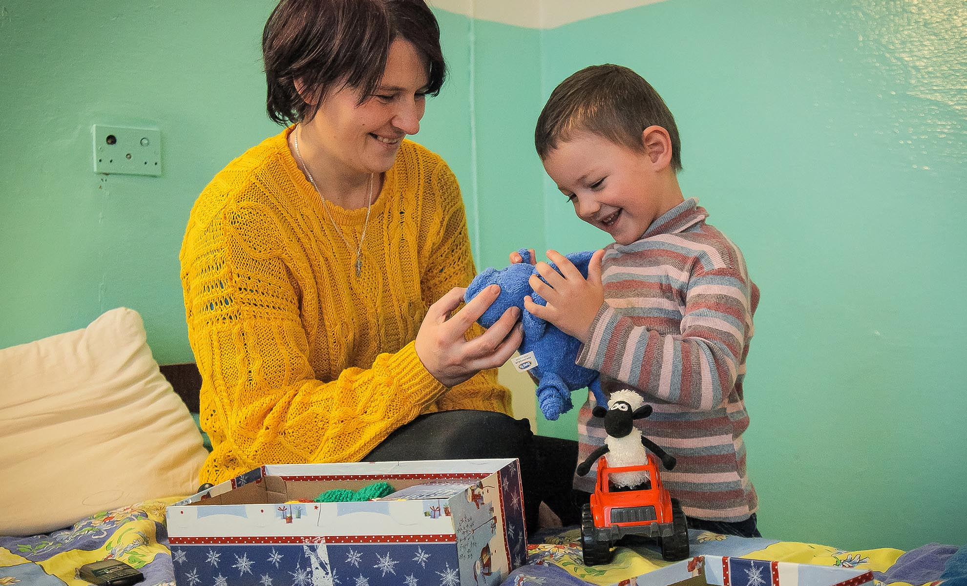 Header image - child and adult exploring shoebox gift