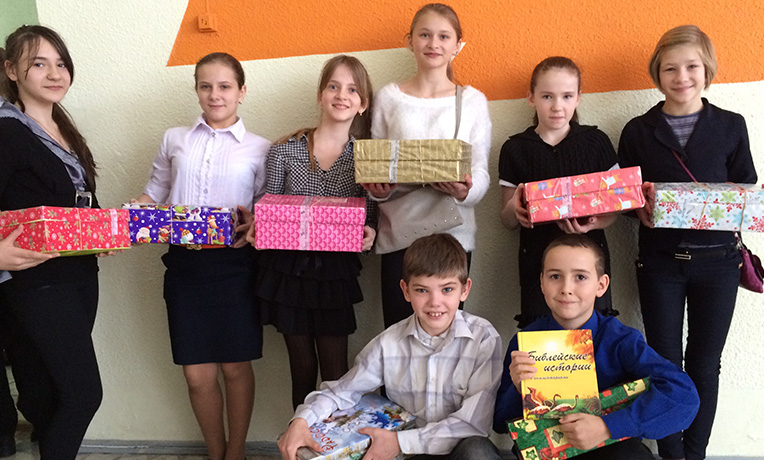 Group of children showing shoeboxes