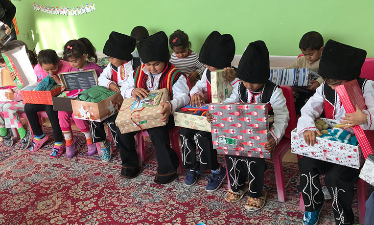 Children opening shoebox gifts