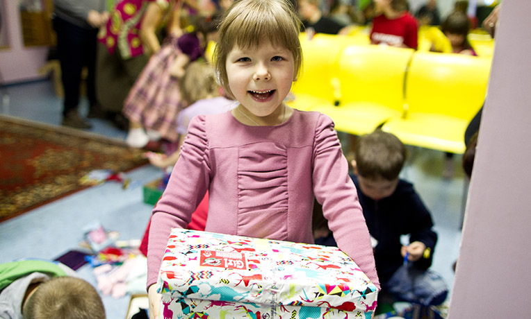 Girl with wrapped shoebox gift