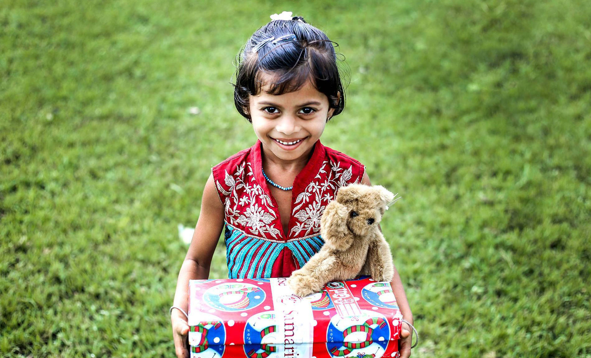 Girl with shoebox and teddy