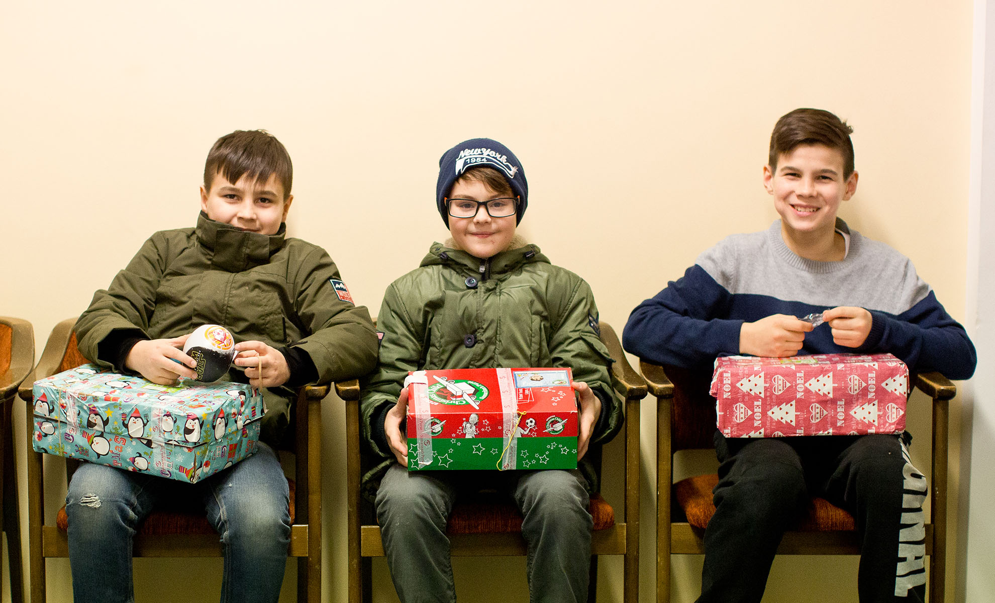 3 boys with shoebox gifts