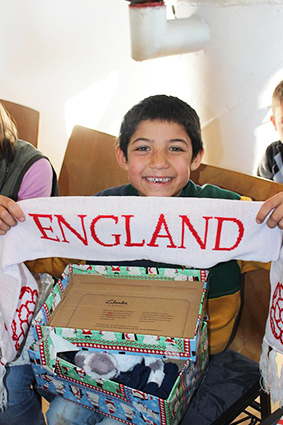 Boy smiling with England scarf