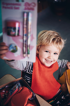 child shows off new stationery
