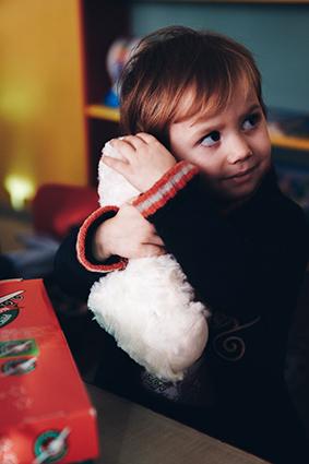 Child hugs new cuddly toy friend