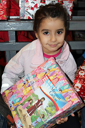 Girl with shoebox and the greatest gift