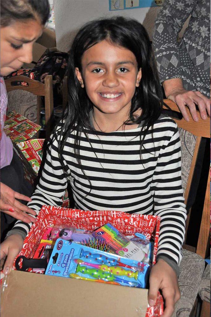 Girl with open shoebox gift