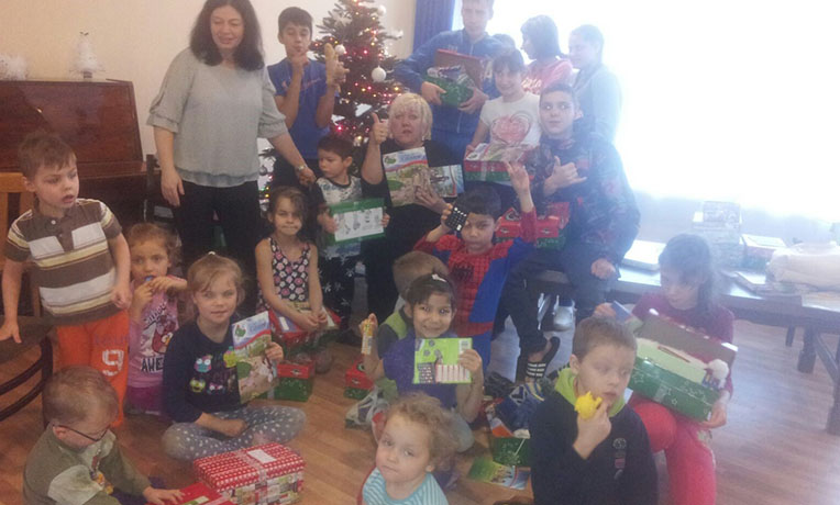 Group with shoeboxes in Latvia