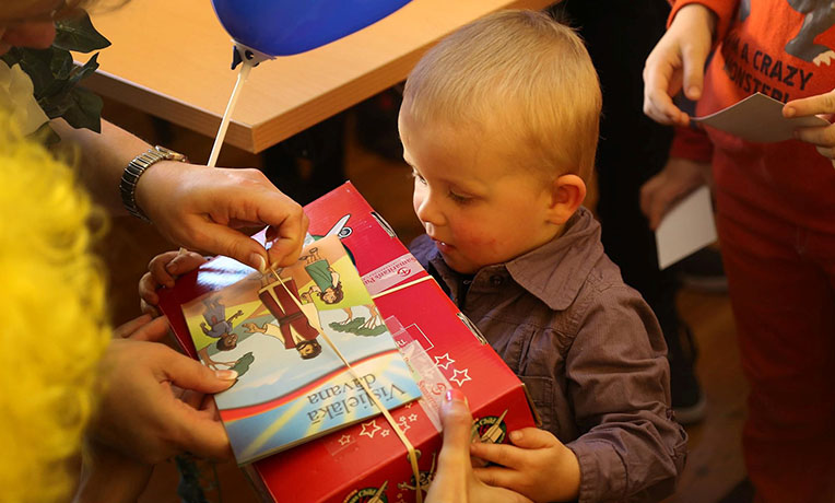 Little boy receiving shoebox gift